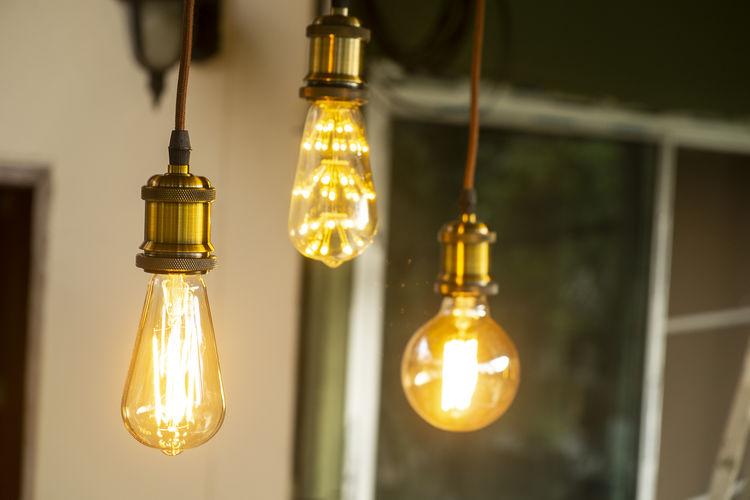 Classic retro incandescent led electric lamp on blur background,vintage light bulb