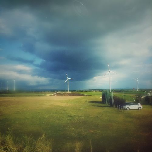 Traveling Renewable Energy Wind Power Wind Turbine Windmill Fuel And Power Generation Environmental Conservation Rural Scene Environment Field Landscape Sustainable Resources Grass Power In Nature Scenics Nature Cloud - Sky Tranquility Green Color Tranquil Scene