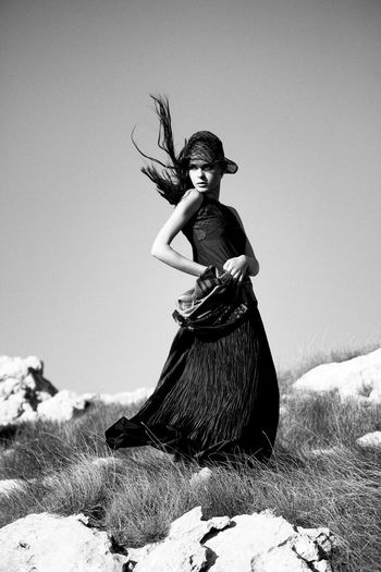Retro styled fashion The Week on EyeEm Vogue Style Blackandwhite 1920's Dressed Woman 1920's Style Black Dress Fashion Stories Hat Nature Beautiful Woman Clothing Fashion Model Field Hair In The Wind High Fashion Long Skirt Mountain Retro Styled Rocky Nature Scarf Standing Wind Young Women