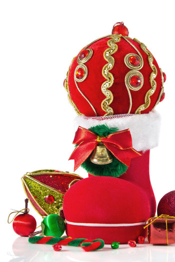 Close-up of christmas decorations over white background