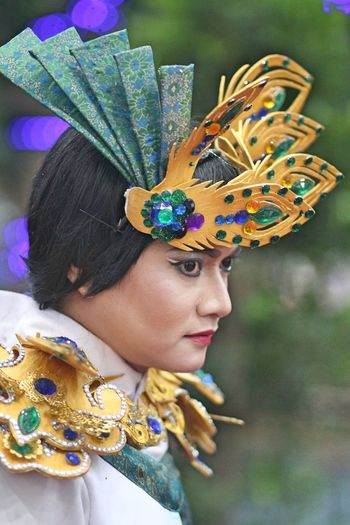 Side View Of Thoughtful Woman In Traditional Clothing During Festival