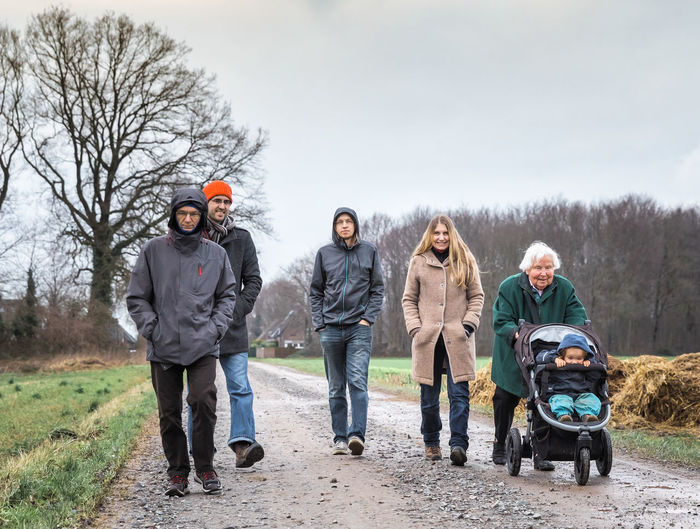 Multi-generational family walking on footpath between fields - Kempen, Germany, Europe 90 Plus Active Adult Baby Bonding Buggy Carriage Caucasian Child Daughter Dirt Family Field Footpath Full Length Germany Girl Grandchild Granddaughter Grandfather Grandmother Grandparent Great Group Happy Joy Love Man Mature Mixed Age Mother Multi-generational Offspring Outdoors Parent People Portrait Pushing Road Rural Senior Stroller Toddler  Togetherness Tree Vitality Walking Warm Clothing Winter Woman Group Of People Men Leisure Activity Women Sky Day Males  Mid Adult Looking At Camera Nature Females Real People Mature Men Mature Adult