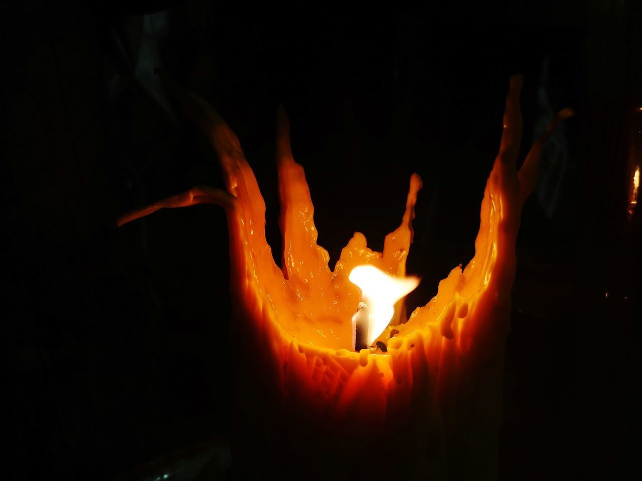 heat - temperature, burning, fire, flame, fire - natural phenomenon, orange color, glowing, nature, no people, close-up, dark, indoors, night, motion, candle, illuminated, wood - material, black background, event, blurred motion, melting