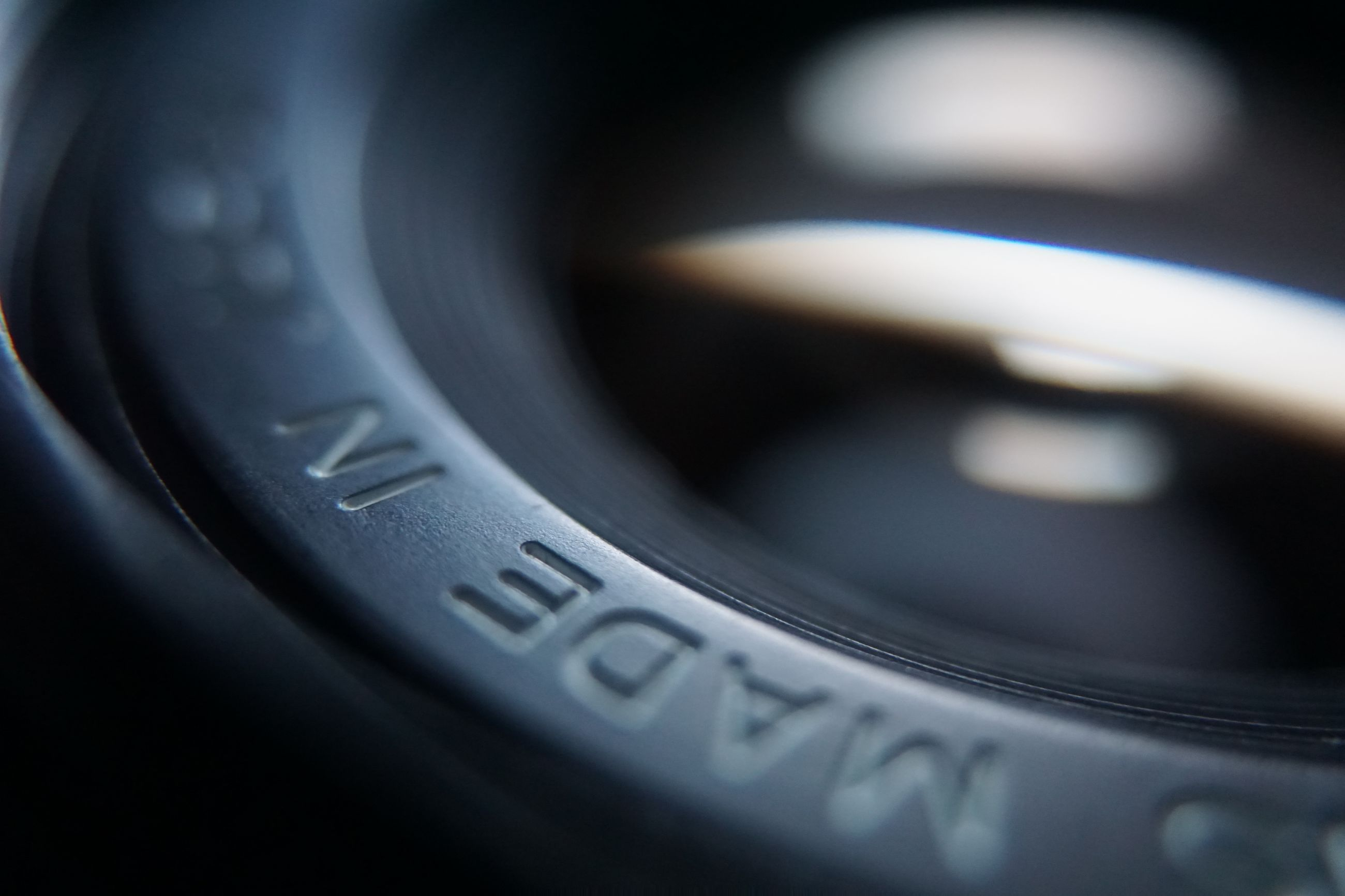 technology, photography themes, close-up, camera - photographic equipment, no people, selective focus, photographic equipment, camera, lens - optical instrument, indoors, digital camera, text, western script, black color, number, equipment, optical instrument, still life, studio shot, communication, slr camera