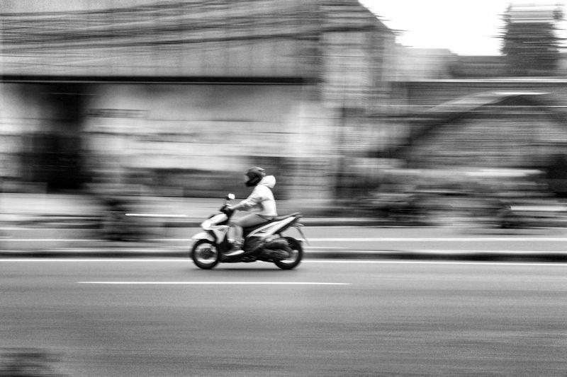 Man riding motorcycle on street