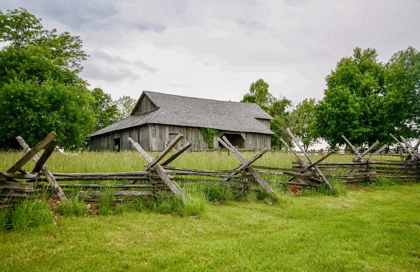 Old Barn & Split Rail Fence at Missouri Town near Kansas City Farm Life In The 1850's Split Rail Fence Barn Plant Built Structure Architecture Tree Building Exterior Sky Nature Building No People Green Color Growth Grass Cloud - Sky Roof Field Outdoors Landscape