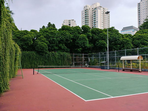 Architecture Building Exterior Built Structure City Court Day Green Color No People Outdoors Sky Sport Tennis Tree