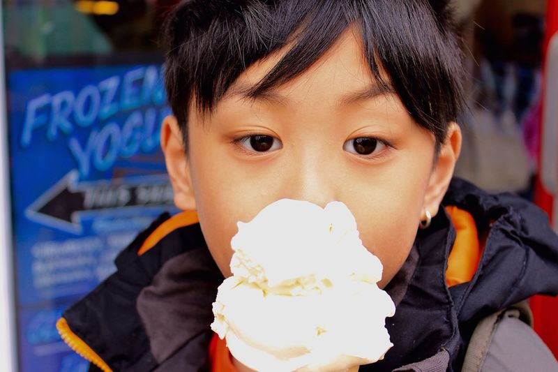 Close-Up Of Boy Looking At Ice Cream