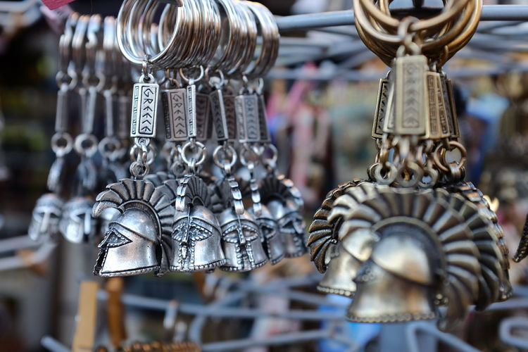 Ancient Antique Casque Close-up Culture Design Focus On Foreground Greek Helmet History Key Chain Key Ring Market Market Stall Metal Metallic No People Selective Focus Shiny Shopping Souvenirs Still Life Tourism Warrior