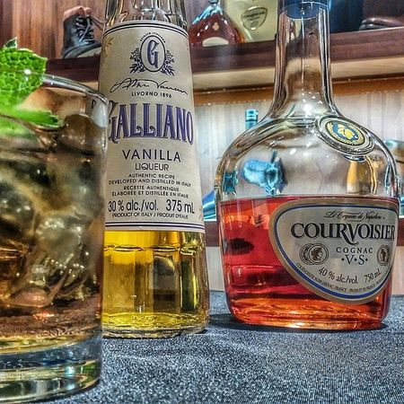 My drink for summer 2014. Off The Cuff: 1oz - Courvoisier VS 1/2oz of Galliano 3oz of Ginger Beer Garnish with a mint sprig Courvoisier Liquor Cognac