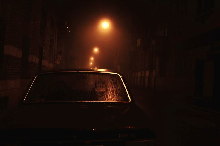 Car in illuminated city
