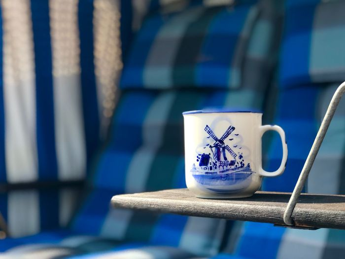Cup of coffee Blue No People Close-up Focus On Foreground Mug Cup Still Life Text Pattern Day Indoors  Creativity Food And Drink Communication Nature Drink Western Script Emotion Sunlight