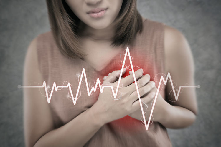 The Asian woman suffering from chest pain on a cement wall background. People having heart disease or heart attack. Hands pressing on the chest with a painful Because of Severe angina symptom Heartbeat Heartache Diseases Heart Attack Heartattack Chest Angina Sudden Pain Ache Strokes Cardiac Cardiovascular Woman Chest Pain Hurt Breathing Lung Cardiopathy Cardiology Myocardial Vessels Electrocardiogram Aorta One Person Real People Women Indoors  Front View Holding Lifestyles Young Adult Midsection Adult Casual Clothing Young Women Leisure Activity Communication Human Hand Focus On Foreground Text Hand Teenager Hairstyle Finger