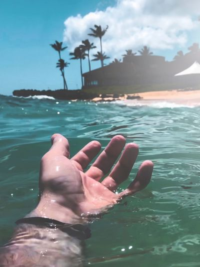 Ocean Hawaii Water Human Body Part Real People One Person Human Hand Hand Sea Lifestyles Body Part Leisure Activity Nature Human Finger Finger Beauty In Nature Personal Perspective Sky Cloud - Sky Day