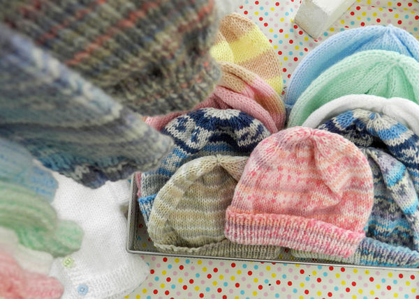 Hand-knitted baby clothes hanging up Baby Clothing Children Fashion Knitting Baby Clothes Babyhood Close-up Fabric Knitted  Knitwear Multi Colored Textile Wool Wool Hat Woolly