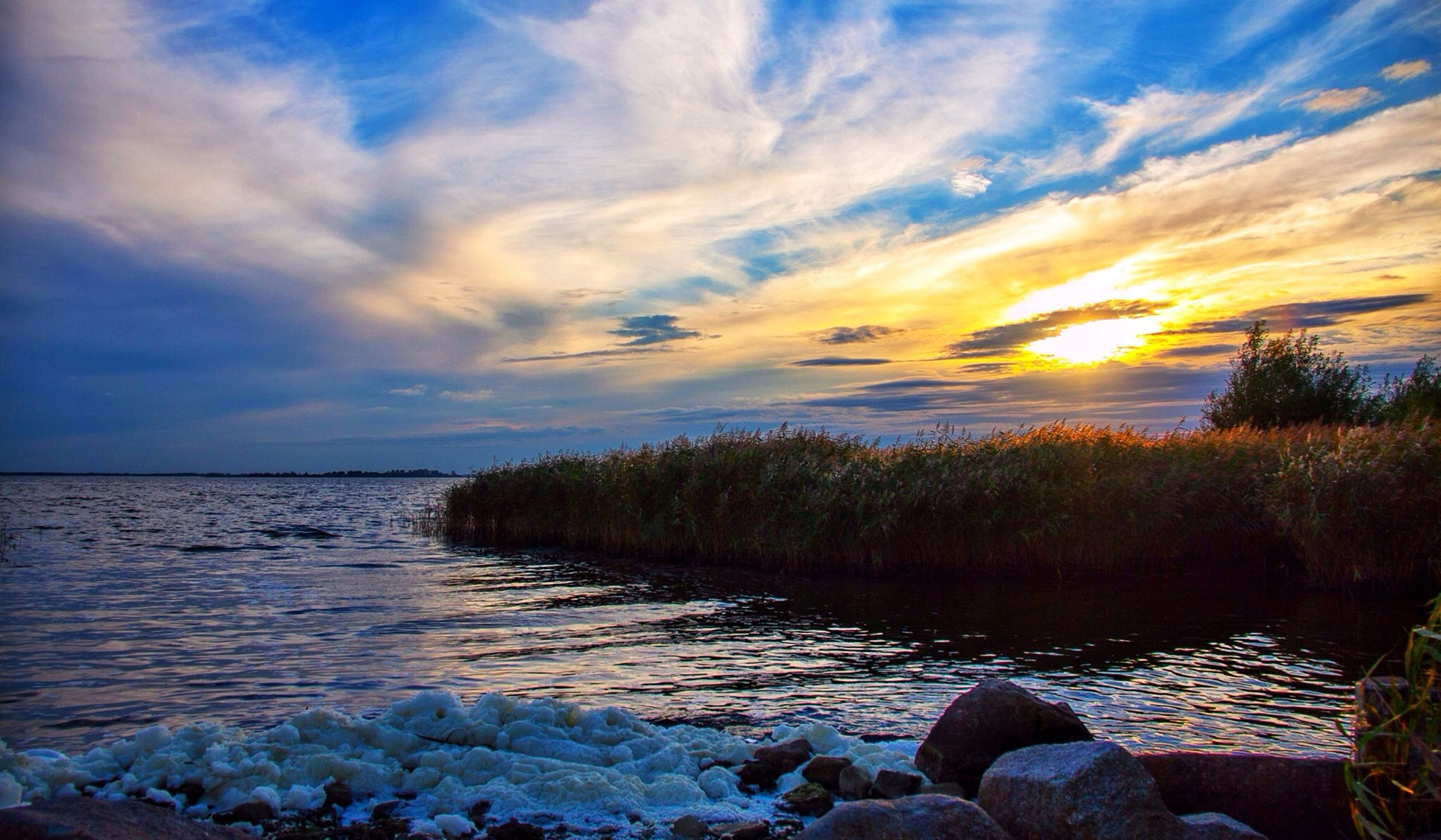 water, scenics, tranquil scene, sky, beauty in nature, tranquility, sunset, nature, cloud - sky, rock - object, sea, idyllic, reflection, cloud, lake, non-urban scene, outdoors, remote, horizon over water, non urban scene