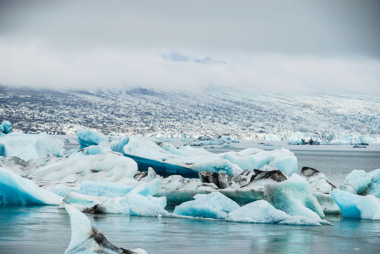 Iceland Jökulsárlón Beauty In Nature Cold Temperature Floating On Water Frozen Glacial Glacier Ice Iceberg Iceberg - Ice Formation Lake Landscape Melting Nature No People Outdoors Polar Climate Scenics Sky Snow Tranquil Scene Tranquility Water Winter