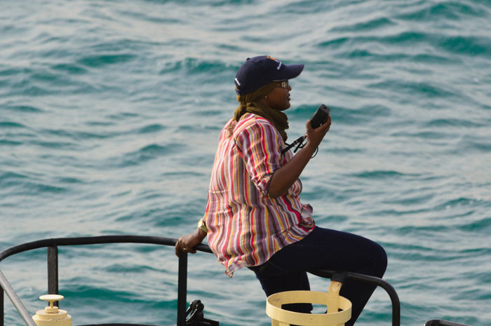 Djibouti Port pilot woman Adult Adults Only Boat Deck Journey Lifestyles Nikon 500mm F8 Nautical Vessel One Man Only One Person Only Men Outdoors People Pilot Port Portrait Portrait Of A Woman Real People Sailing Sea Travel Vacations Water Woman Woman Portrait Young Adult