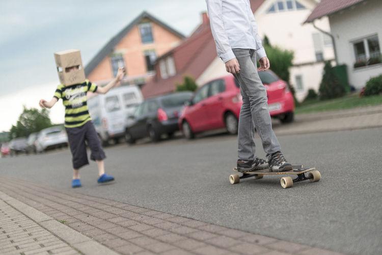 Low section of boy skateboarding