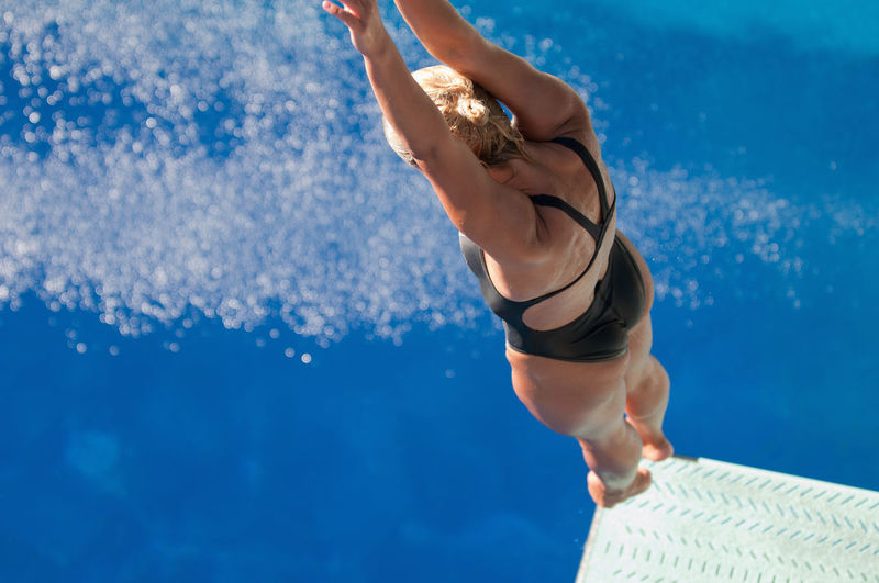 Springboard Diver 20s Athlete Copy Space Diving Jump Springboard Jumping Sunlight Swiming Water Sport Blue Caucasian Copyspace Dive Outdoors Pool Sport Spring Board Springboard Springboard Diver Summer Swimming Pool Underwater Unusual Angle Water Young Women