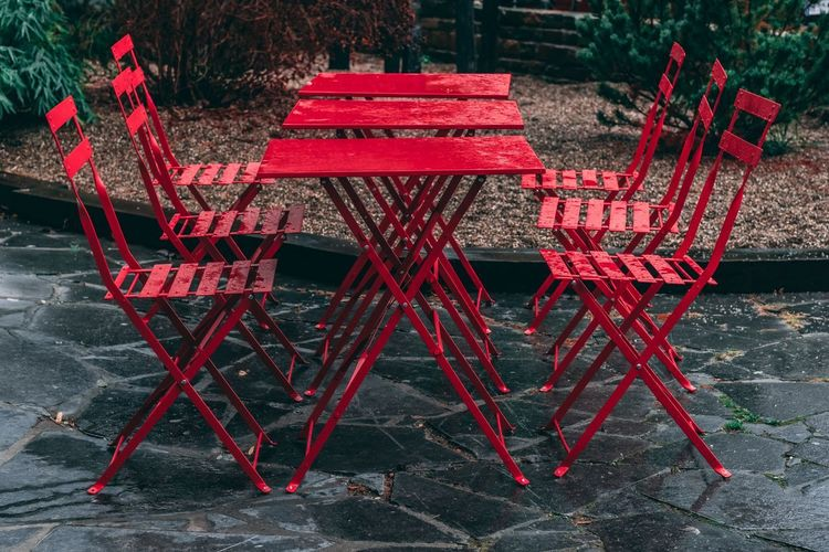 When Rain Takes All the Seats Red Chair No People Absence Empty Bench Outdoors Table Furniture Rain Rainy Days Rain In The City Perspective Myperspective Leading Lines Group Of Objects Moodygrams Mood