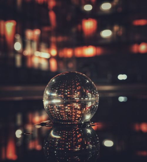 Close-up of illuminated crystal ball