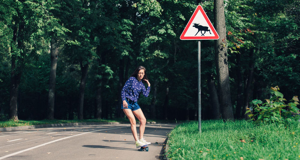 Summer almost gone Mobility In Mega Cities Signs Skateboarding Adult Day One Person One Woman Only Outdoors Pennyboard Real People Road Roadsign Skater Girl Tree Stories From The City The Street Photographer - 2018 EyeEm Awards