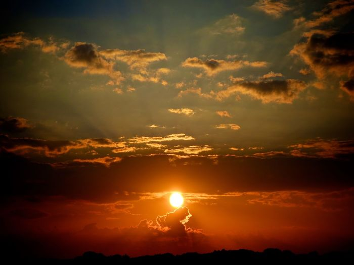 Maybee God? Beauty In Nature Bright Cloud - Sky Dramatic Sky Environment Idyllic Landscape Nature No People Non-urban Scene Orange Color Outdoors Scenics - Nature Silhouette Sky Sun Sunbeam Sunlight Sunset Tranquil Scene Tranquility Summer Exploratorium