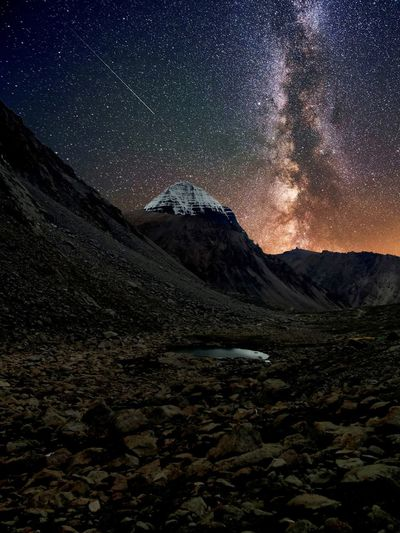 Scenic view of mountains against milky way