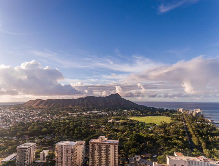 Aerial view of Diamond Head in Honolulu Hawaii Hawaii Oahu Waikiki Architecture Beauty In Nature Blue Building Exterior Built Structure City Cityscape Cloud - Sky Day Diamond Head Honolulu  Mountain Nature No People Ocean Outdoors Park Scenics Sky Tourism Travel Destinations Tree
