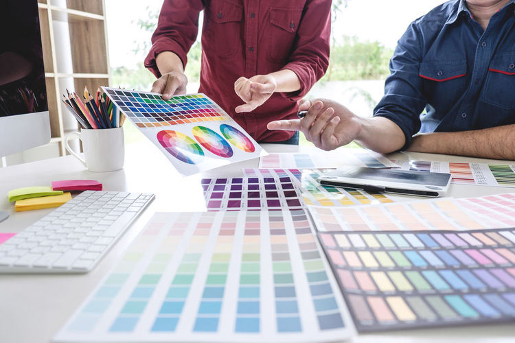 Adult Art And Craft Business Casual Clothing Colleague Color Chart Color Swatch Colorful Creativity Design Professional Desk Drawing Front View Graphic Design Indoors  Men Multi Colored Occupation Office Pantone Paper People Swatch Two People Working