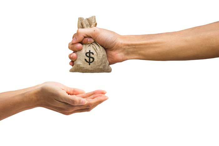 Man hand holding money bag and giving money to another person isolated on white background with clipping path easy to use for design your work. Receive Body Part Close-up Communication Copy Space Cut Out Economy Finance Finger Giving Hand Holding Human Body Part Human Hand Human Limb Indoors  Men Money Number One Person Studio Shot Text Unrecognizable Person Wealth White Background