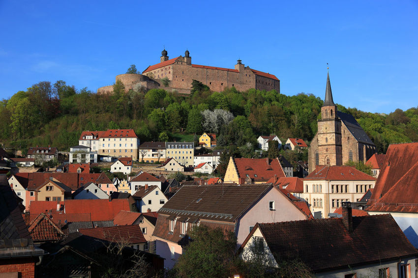old city and castle Plassenburg of Kulmbach, Frankonia, Bavaria, Germany Plassenburg Architecture Blue Building Building Exterior Built Structure City Day House Kulmbach Nature No People Outdoors Place Of Worship Plant Religion Residential District Roof Sky Town TOWNSCAPE Tree