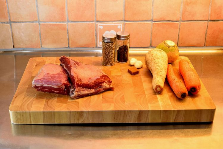 Close-Up Of Ingredients On Cutting Board In Kitchen