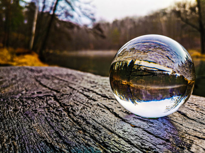 Close-up of crystal ball on wooden surface