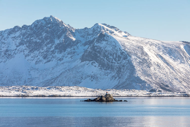 Beauty In Nature Clear Sky Cold Temperature Day Fjord Frozen Idyllic Lighthouse Lofoten Mountain Mountain Range Nature No People Norway Outdoors Refelction  Scenics Sky Snow Snowcapped Mountain Tranquil Scene Tranquility Water Waterfront Winter