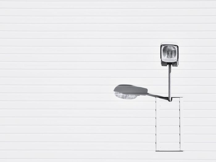 Lighting Equipment On White Wall During Sunny Day