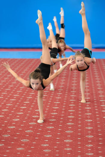 Athlete Caucasian Child Exercise Female Girl Group Gymnast  Gymnastics People Sportive Sportsman Stretch Student Teenager