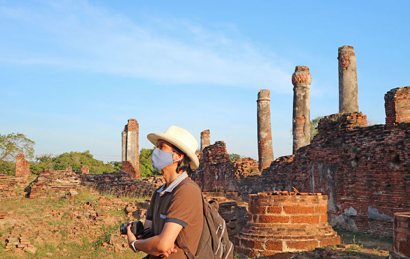 Visitor wearing face mask visit to wat phra si sanphet temple amid covid-19, ayutthaya, thailand