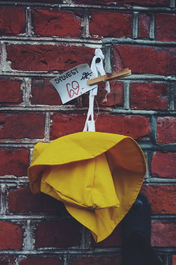 Southwest rain hat for sale Wall - Building Feature No People Day Outdoors Built Structure Yellow Architecture Building Exterior Close-up Hat Hats Rainy Days Rain Rain Habits Sydvest Sydvesten For Sale Southwest  Stories From The City
