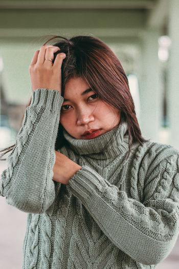 Portrait of young woman in winter