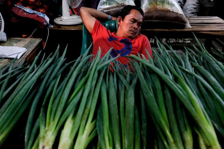 Full length of a man in market