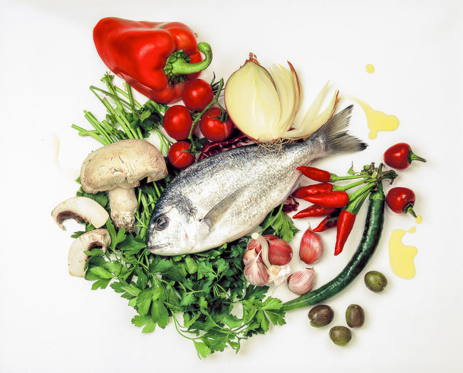 Fisch Food Garlic Gastronomy Ingredientes For Cooking Fish Olive Oil Olives Onion Parsley Red Hot Chili Peppers Sea Bream Spices
