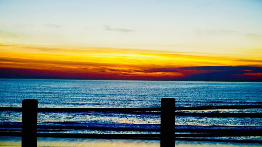 Horizon Bluemonday Janvier 2018 Pacific Ocean Blue darkness and light Yellow Color Sonyalpha Eyemphotography EyeEm Nature Lover EyeEmNewHere California San Diego Railing Sea Sunset Scenics Water Tranquil Scene Beauty In Nature Horizon Over Water Sky Tranquility No People Nature Idyllic
