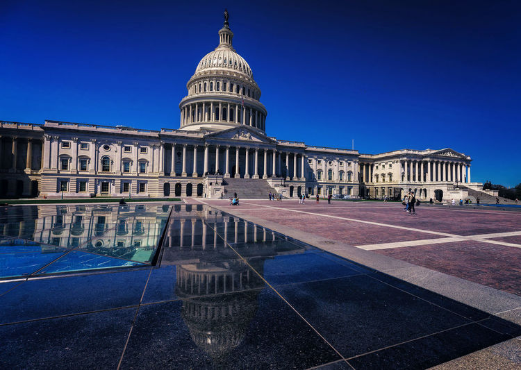 The Capitol N Capitol Reflection EyeEmNewHere US Capitol Building Architecture Building Exterior Built Structure Dome Government Politics Reflections In The Water Sky