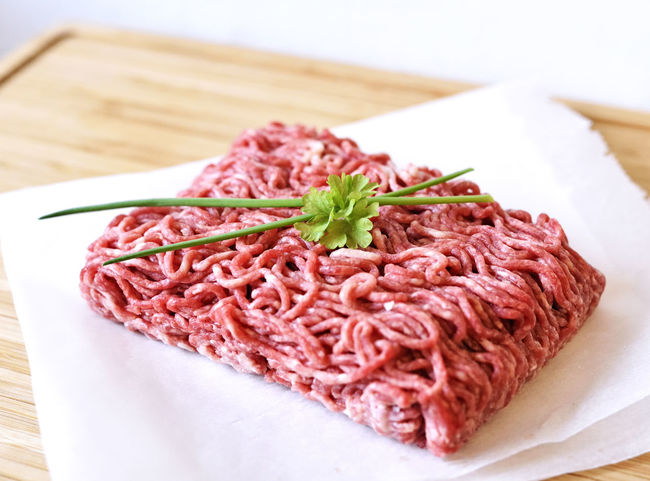 raw minced meat top view or high angle shot of minced pork and beef. Freshness Raw Raw Meat   Close-up Food Food And Drink Fresh Fresh Meat Freshness High Angle View Indoors  Minced Minced Beef Minced Meat Minced Pork No People Parlsey Plate Raw Beef Raw Food Red Meat Still Life Table Top View Wellbeing
