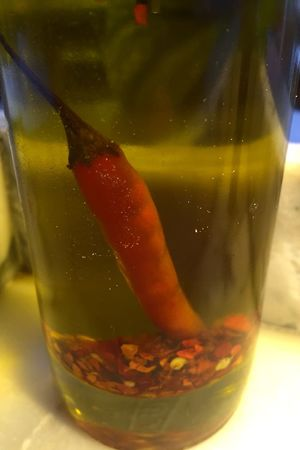 then oil fell in love with water Oil Bottle Oil Chili  Food Mediterranean  Mediterranean Food Sophistication