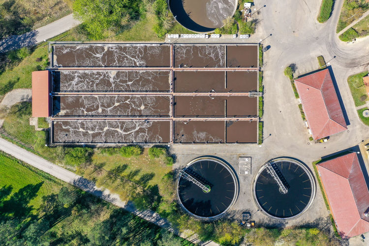 Aerial view of a purification plant Environmental Clean Up Pool Purification Sewage Plant Water Cleaning Aerial Imagery Directly Above High Angle View Cleaner