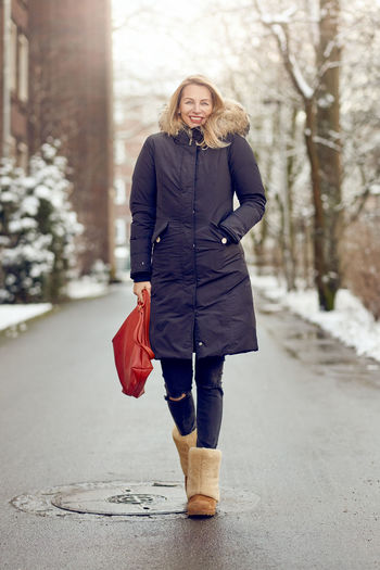 Attractive middle-aged blond woman in warm winter coat Public Park Sidewalk Slim Winter Woman Best Ager Blond Coat Cold Temperature Female Full Body Middle-aged Slender Streetphotography Urban Walking Warm Clothing