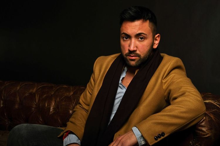 Gentleman. Variation Casual Winter Fashion Freshness Photography People Gentlemen Portrait Art One Person Young Men Young Adult Front View Beard Sitting Clothing Facial Hair Furniture Real People Indoors  Lifestyles Males  Looking At Camera Portrait Adult Men Sofa Looking Warm Clothing